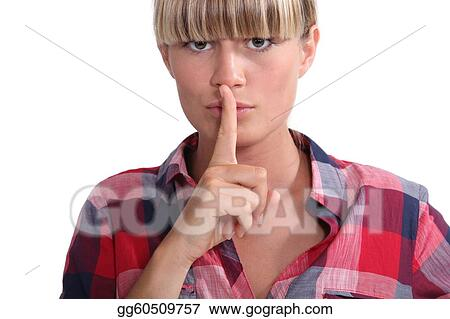 Young woman with a blunt fringe holding her finger to her lips