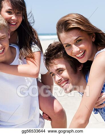 Young women enjoying piggyback ride