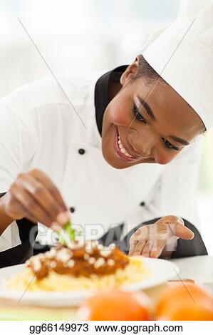Stock Photograph African American Chef Decorating Pasta Dish Image Gg66149973 Gograph