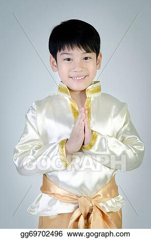 Asian Cute Boy In Thai Costume Acting Hello In Thai On Gray Background