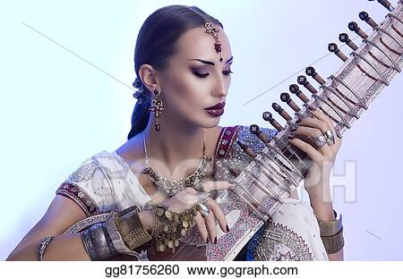 d5218ea54d Beautiful Indian Woman in Sari with Oriental Jewelry Playing the Sitar