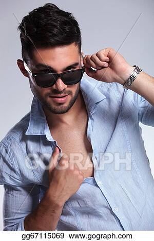 73209cbeded Stock Photo Casual Man Pulls Down Sunglasses And Opens Shirt