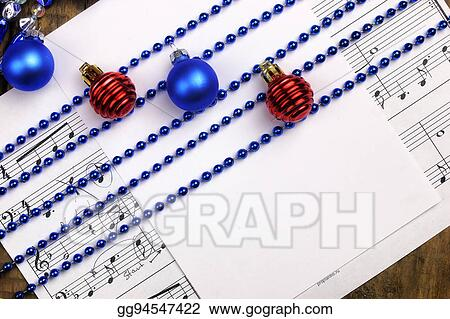 Christmas tree decorations on the table and sheet with music not