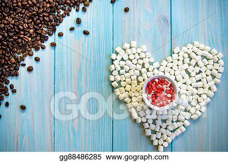 Coffee Cup Full Of Candies Flat Lay On Rustic Light Blue Wooden Background Heart Figure Made From Marshmallows Beans Top Left Corner