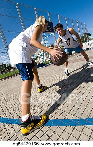 Stock Image Couple Of Young People Playing Basketball Outside