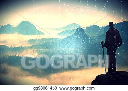 Stock Illustration - Film grain  silhouette of tourist with poles in