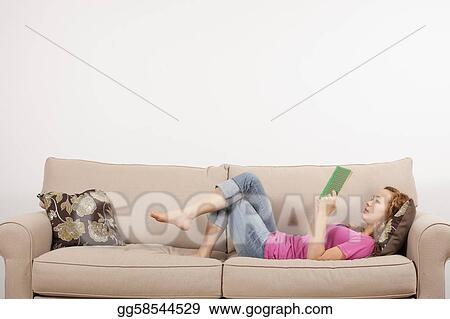 84d48f7cacbd Stock Photo - Girl reading book on couch. Stock Photography ...