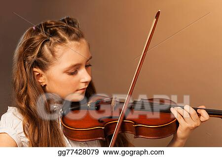 Stock Images - Half-face view of beautiful girl playing
