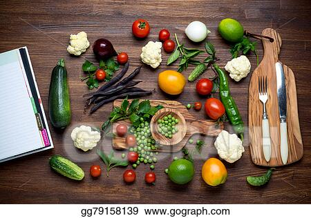 Drawing healthy food herbs and vegetables on wooden table with healthy food herbs and vegetables on wooden table with recipe book top view forumfinder Choice Image