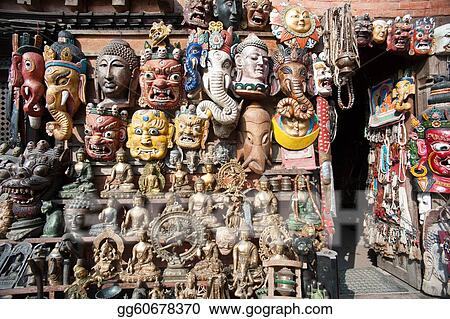 Stock Photography - Masks, pottery, souvenirs, hanging in