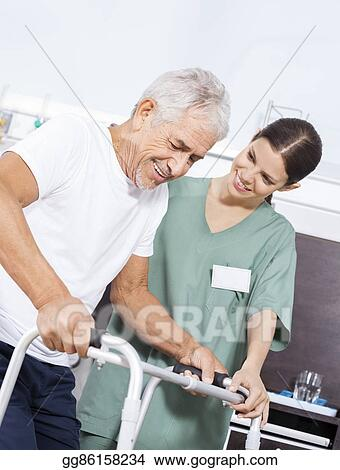 Stock Photos Nurse Looking At Senior Patient Using Walker In Rehab Center Stock Images Gg86158234 Gograph
