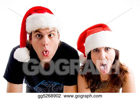 Stock Images People With Christmas Hat And Making Weird Faces