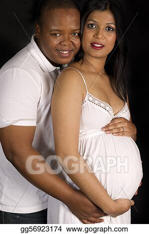 Stock Photography Sexy Beautiful Pregnant Indian Woman And African Male Embracing In White Dress Smiling On Black Backdrop Stock Image Gg56923174 Gograph