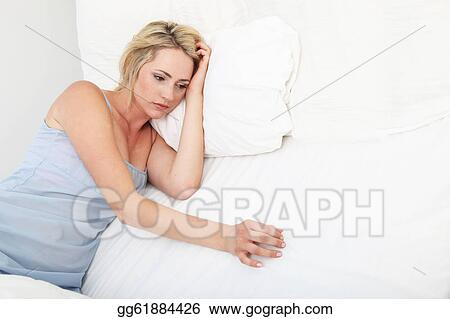 Stock Photography Sick Depressed Woman Propped Up On Pillows