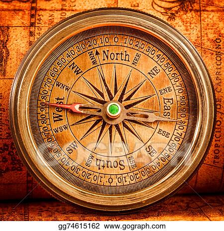 Stock Photography - Vintage compass lies on an ancient world map