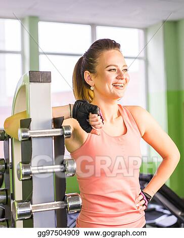 Stock photography young adult fit sporty girl posing near shelf
