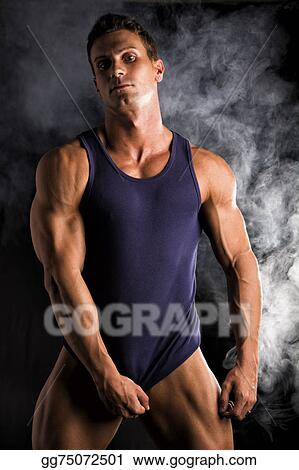 15d302e2bd010 Stock Images - Young athletic man pulling down tanktop on ripped ...
